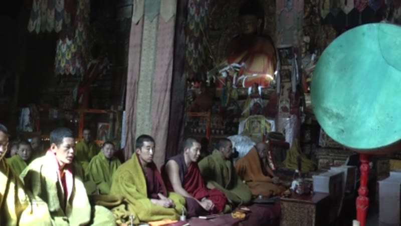 Monks praying inside the main Assembly hall, Sakya Monastery, Tibet 2