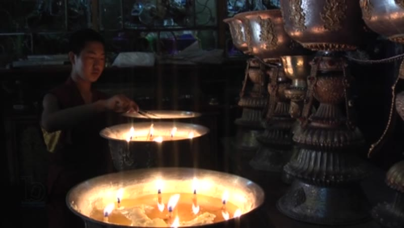 Monk at the lamp pots, Drolma Lhakhang, Lhasa, Tibet