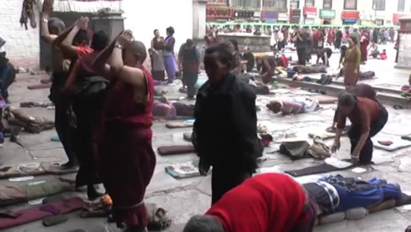 Many people doing Dandavats, Jokhang Temple, Lhasa, Tibet 2