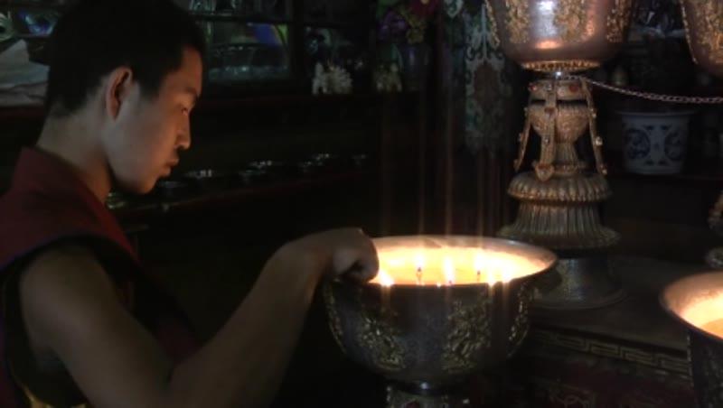 Monk at the lamp pots, Drolma Lhakhang, Lhasa, Tibet 1