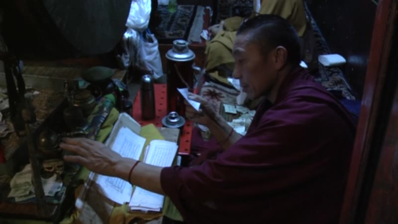 Lama reading Sutra, Ramoche Temple, Lhasa, Tibet
