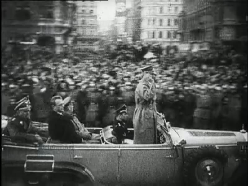 Hitler and Mussert greet the cheering crowd