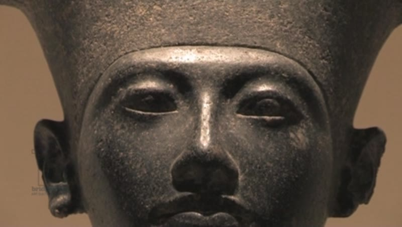 Close up, statue of a diminutive Horemheb standing before before Amun