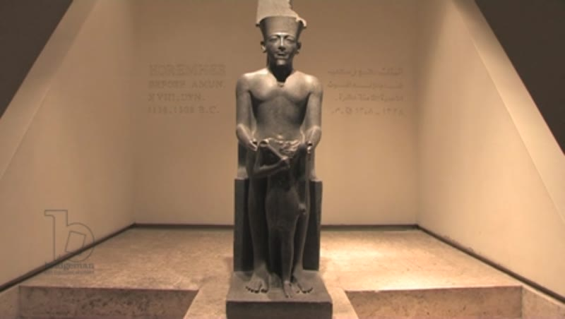 Statue of Horemheb standing before before Amun