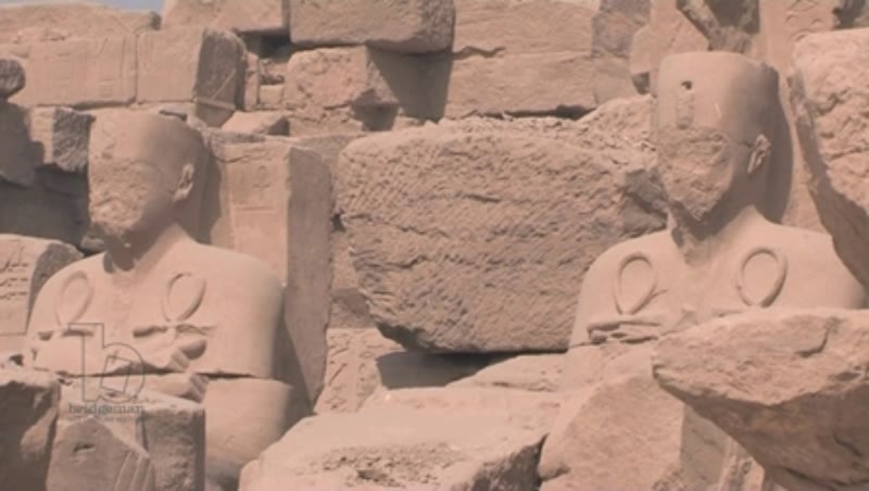 Statues holding ankhs, at the Karnak Temple Complex, Egypt