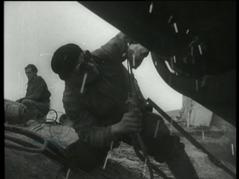 French workers destroy the remains of the bunkers and cannons of the Atlantic Wall. The Atlantic Wall was a defensive line which was set up by the Germans along the French coast