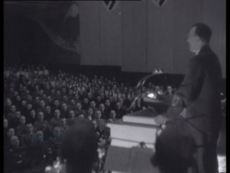 The birthday of Hitler is celebrated at a meeting of members of the NSDAP and NSB
