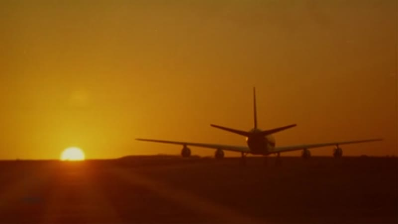 Boeing 707 taxi into sunset