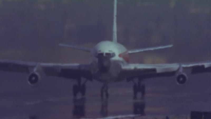 707 takeoff, daytime, closeup on engines