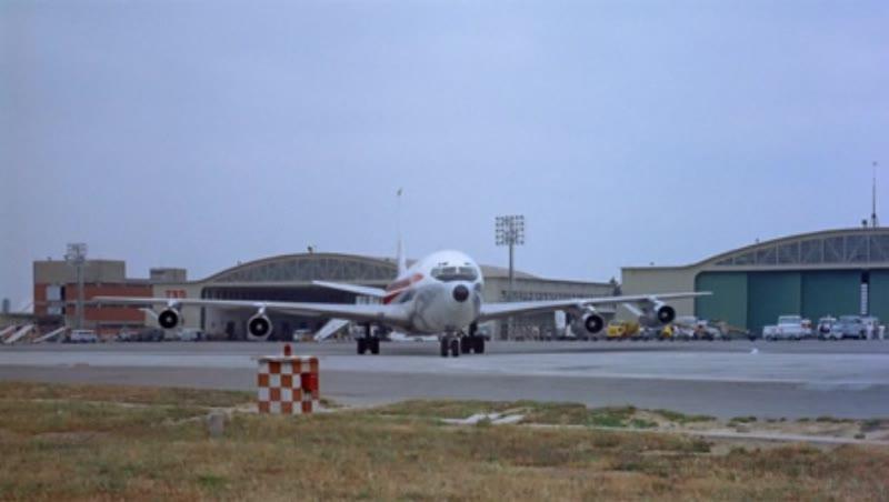 707 on tarmac near hangers