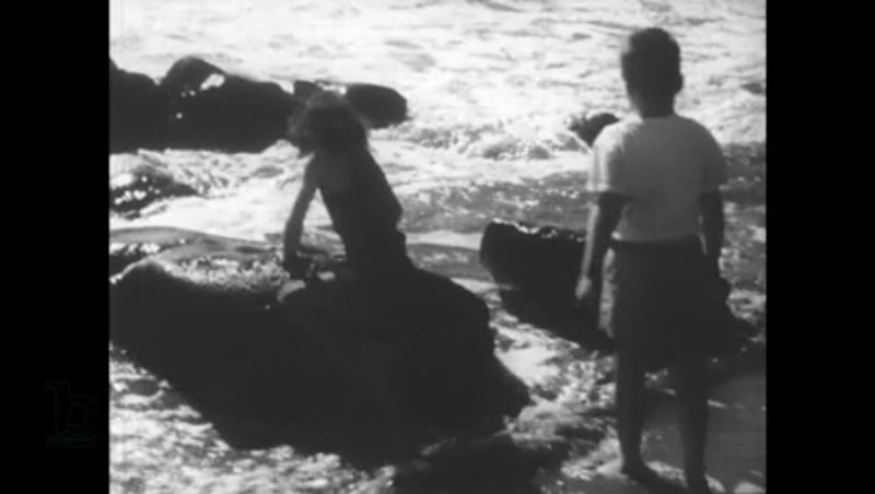 United States, 1950s: Children play by seaside