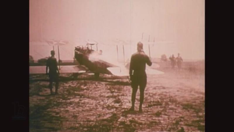 1918: Pilot climbs to cockpit of plane