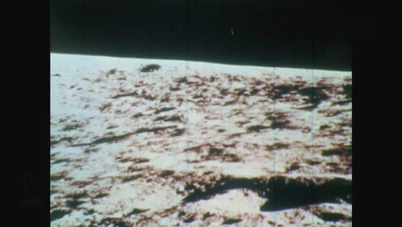 1970s man in spacesuit walks on lunar surface