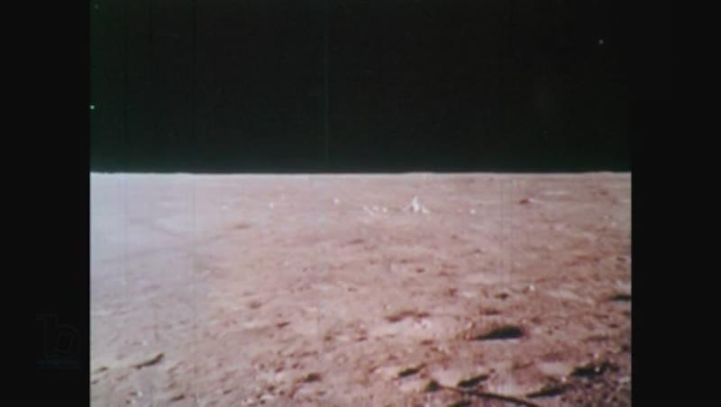 1970s hands inspect moon rocks