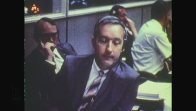 United States, 1970s: men speak to each other at mission control