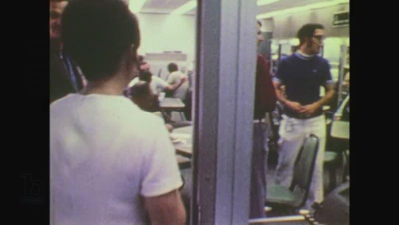 United States, 1970s: astronaut runs across moon towards buggy