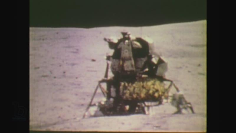 United States, 1970s: astronaut walks towards capsule on moon