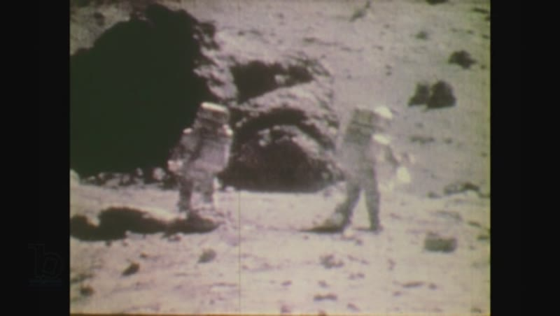 United States, 1970s: men look at photo of moon surface
