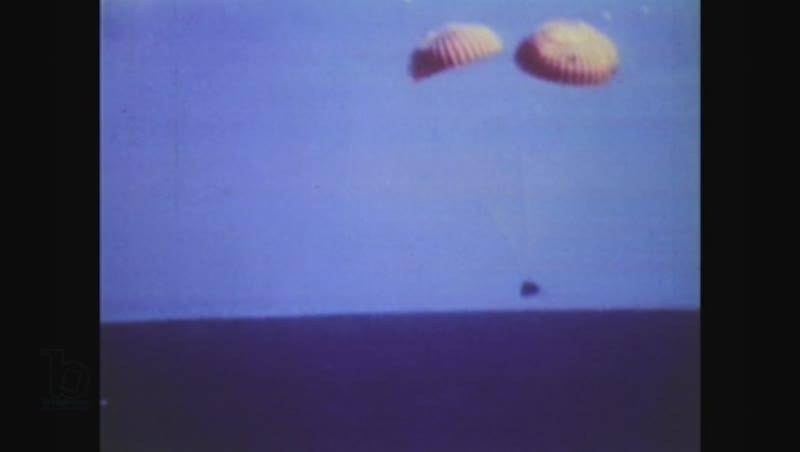 United States, 1970s: space capsule parachutes into ocean