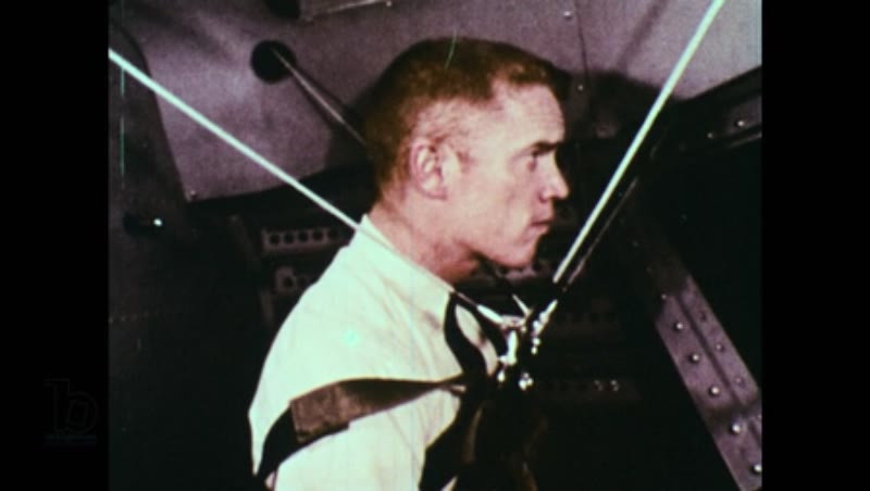 United States, 1960s: Man strapped in to a harness