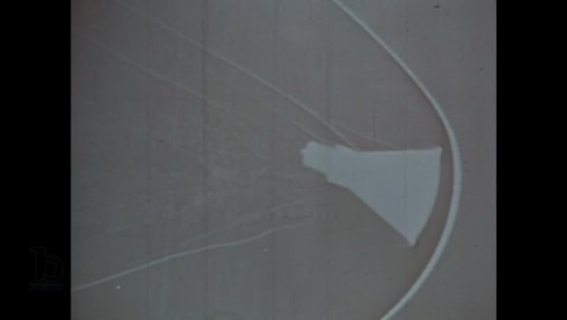 1960s: Man operates shadowgraph. Shadowgraph. Man welds metal capsule.