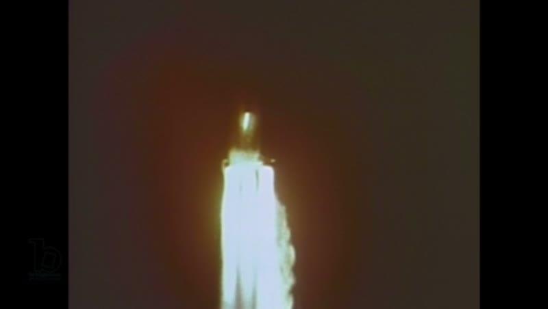 1960s: Space rocket takes off at night. Space rocket flies at night.