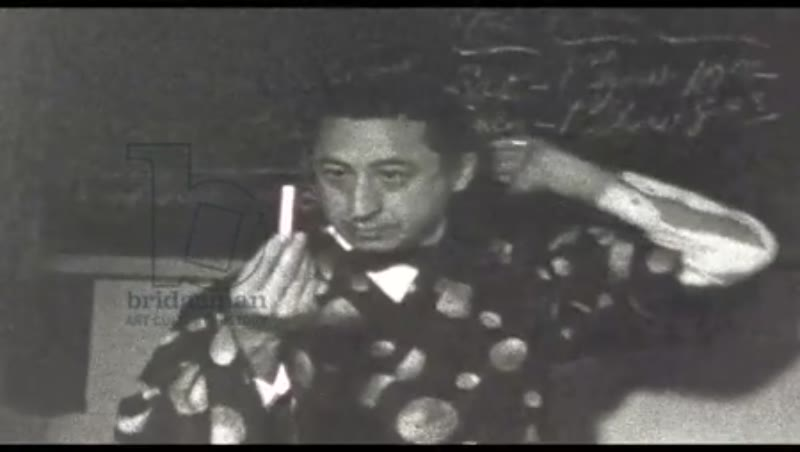 MAN IN FANCY GOWN PERFORMS MAGIC TRICKS, 1940s