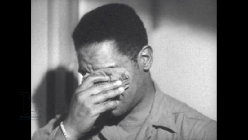 1940s: Soldier sits and cries while talking.