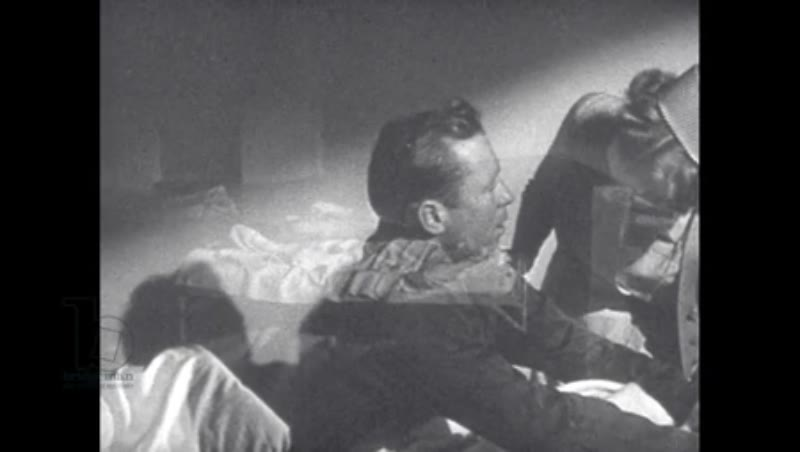 1940s: Man tosses and turns in bed, sits up.