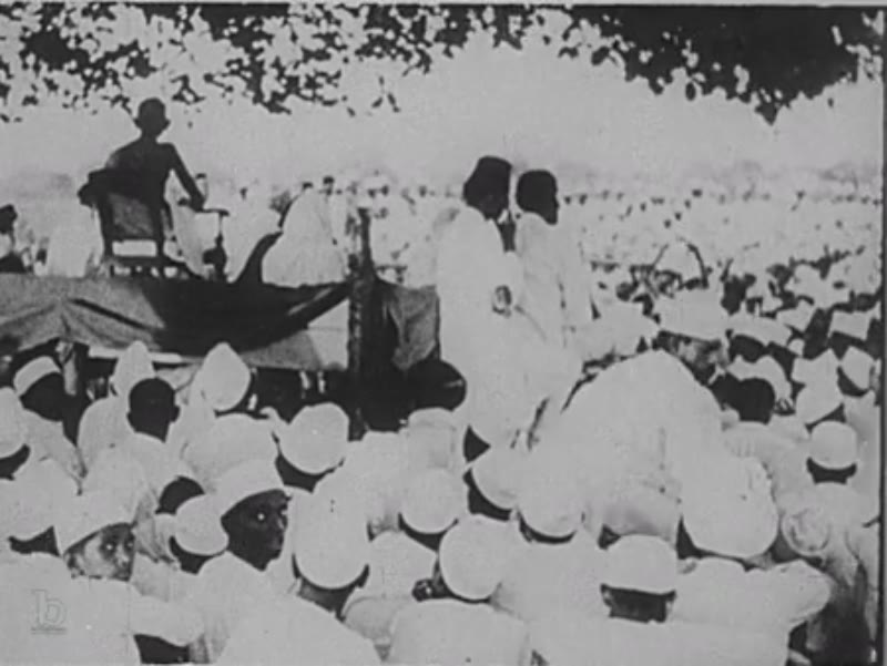 India, c.1930: Gandhi sits and works with thread