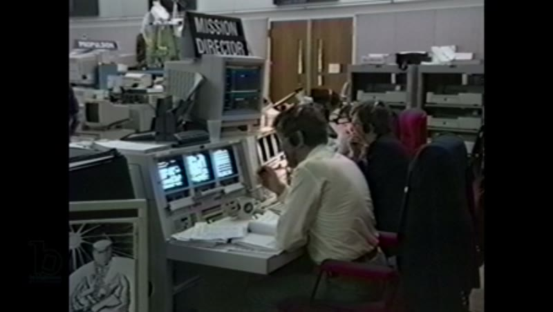 America, c.1990s: Mission control director for space shuttle Endeavour sits at desk in mission control center