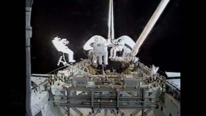 America, c.1990s: Three astronauts on exterior of space shuttle Endeavour in orbit