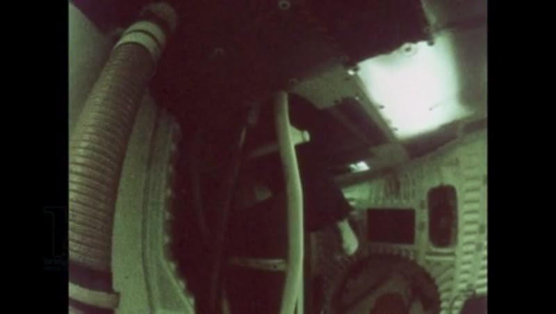 UNITED STATES: 1981: Astronaut floats through space shuttle cabin and up into hatch.