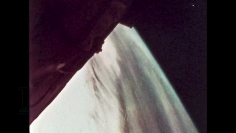 UNITED STATES: 1981: Astronaut safely stows items away inside shuttle.