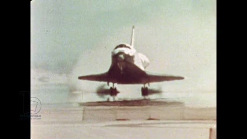 UNITED STATES: 1981: Space shuttle touches down on sandy runway.