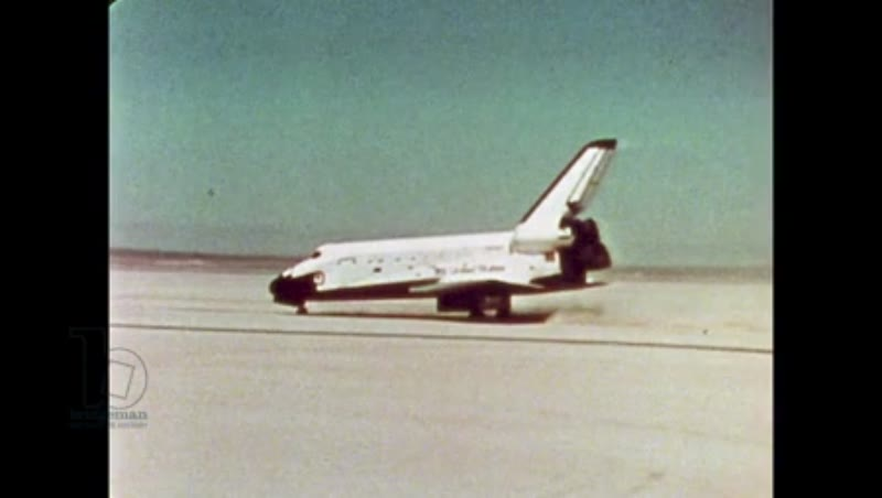 UNITED STATES: 1981: Space shuttle slows down on runway as it lands.