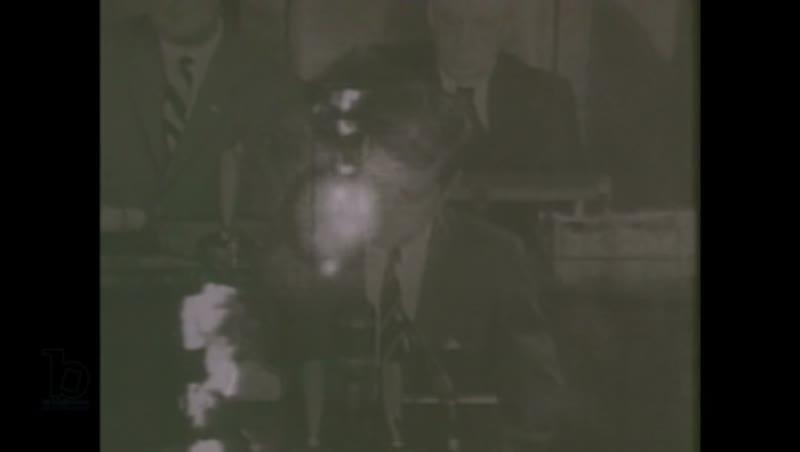 1980s: Man loads gun