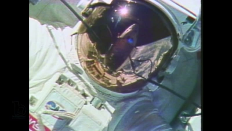 1980s: Astronauts work in docking bay of Space Shuttle, in space