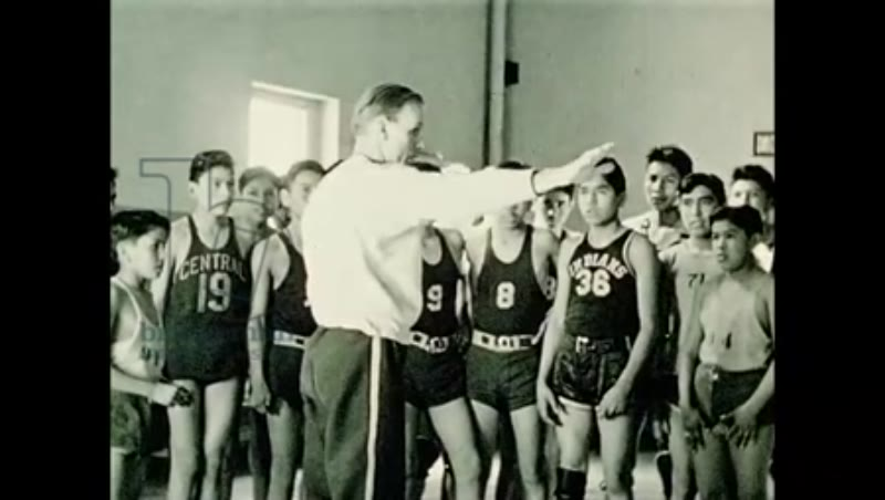 1940s, A team of Native American students play basketball