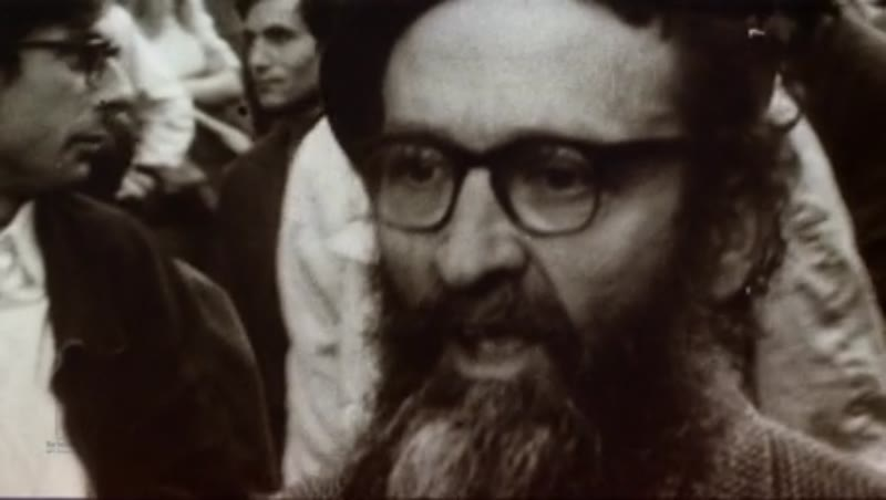 Bearded man protesting at a demonstration in France, 1960s