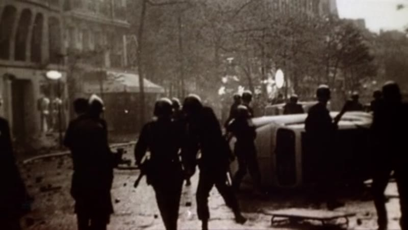Police throw objects during a riot in France, 1968