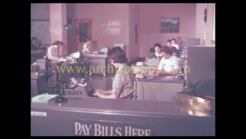 1960S: WOMEN WORK AND TYPE AT DESKS IN TELEPHONE OFFICE.