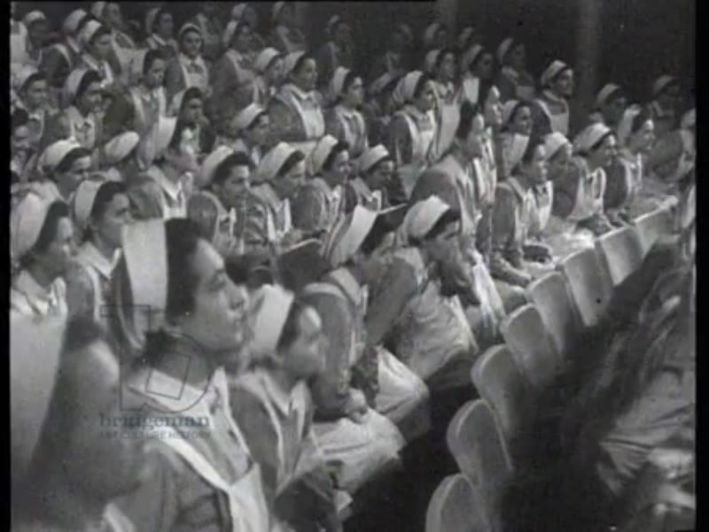 Nurses of the Red Cross take the oath of allegiance. After the ceremony all the nurses bring the Hitler salute