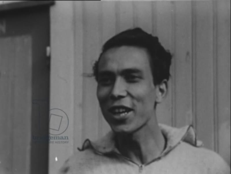 Leiden military in Indonesia. Indonesian man talking and smiling.