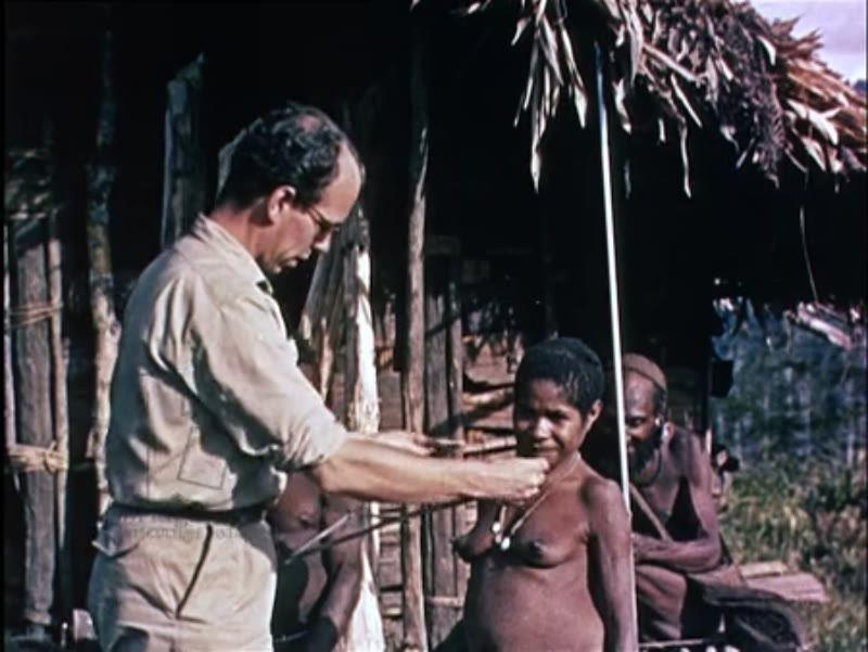 Indonesian tribespeople see Caucasian men for the first time in New Guinea, Indonesia, 1959.