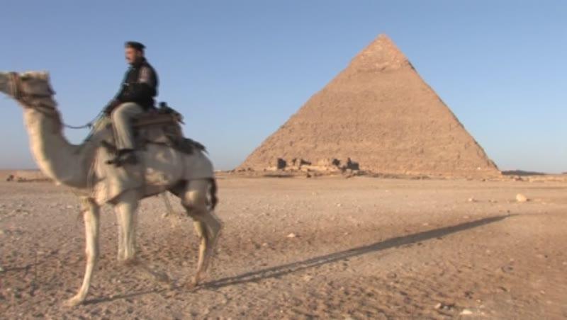 A Policeman riding a camel, Giza