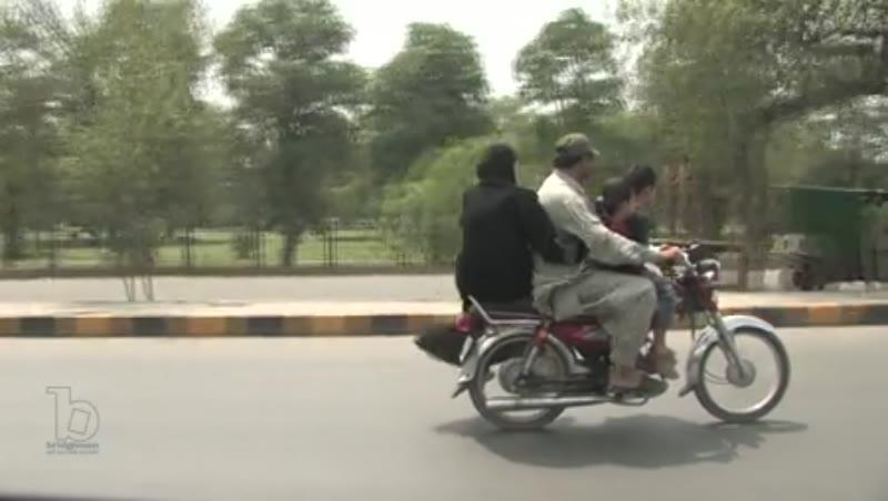 Family riding a bike, Lahore