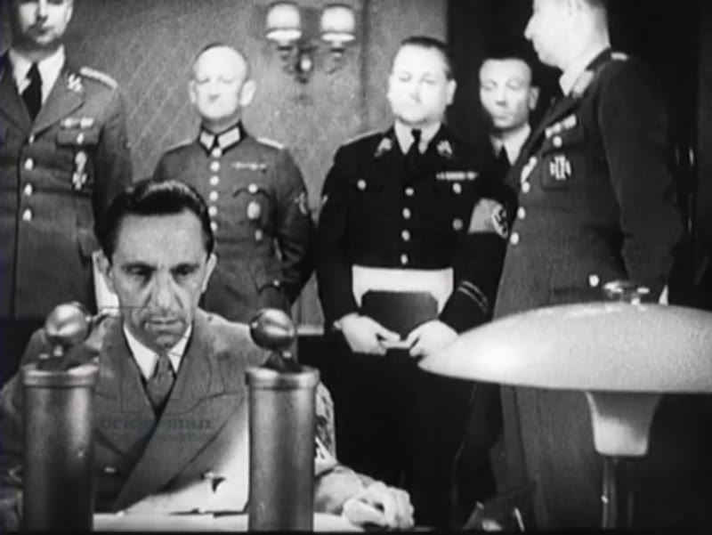 Goebbels reads aloud an announcement from Hitler on the radio, Von Ribbentrop gives a speech for journalists