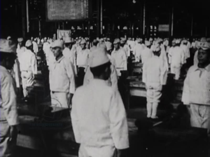 Factory in Indonesia, 1945, where the movements are performed synchronously by all workers