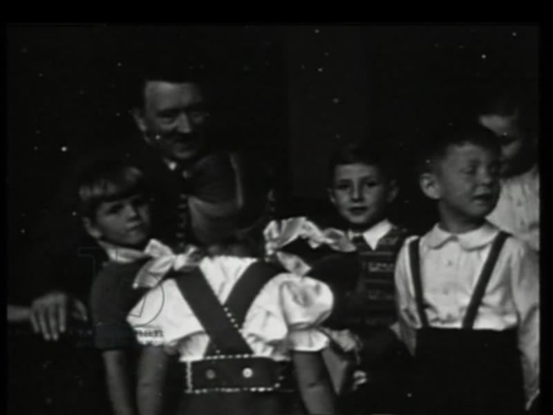 Adolf Hitler and a group of children